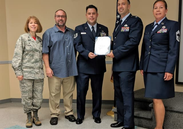 U.S. Air Force Technical Sgt. James P. Connors of New Milford  (center).