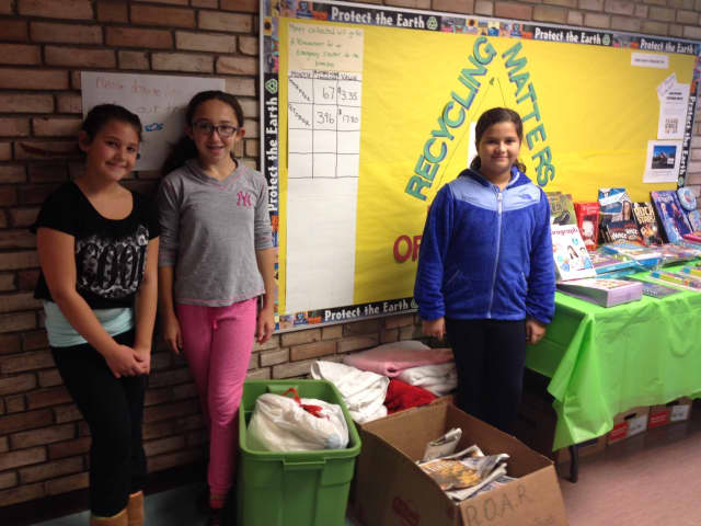 A new club at Meadow Pond Elementary School, Recycling Matters, has brought students together in being kind to the environment and those in need locally and abroad.