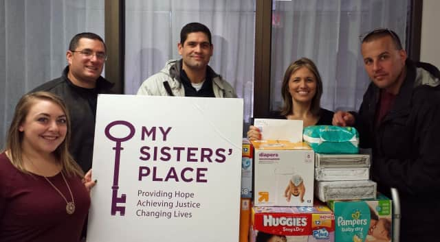 Scarsdale police officials dropping off donations to My Sisters' place last year.