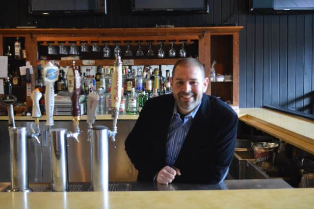 Matt Van Allen stands behind the bar at the Old Forge Spirits and Pub in Ringwood.