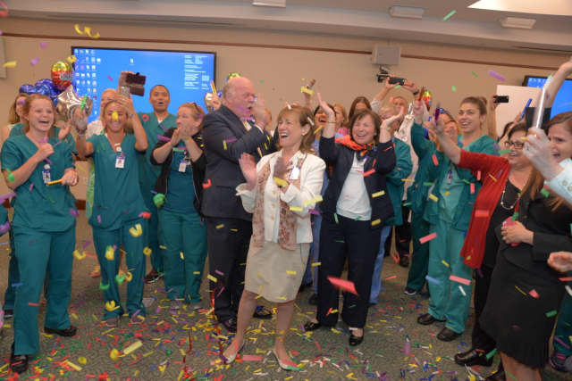 Greenwich Hospital staff join Norman G. Roth, the hospital's president, Sue Brown, executive vice president of Operations and Patient Care Services and Magnet Program Director Priscilla Stone to celebrate the hospital's Magnet designation.