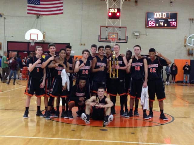 The Mamaroneck Tigers boys' basketball team pose with the Tigers Tournament trophy.