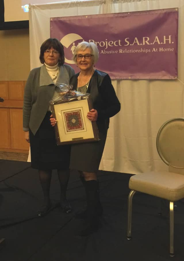 Marcia Levy, NCJW Presidium member, receiving award from Elke Stein, L.C.S.W., Project S.A.R.AH Consortium Director.