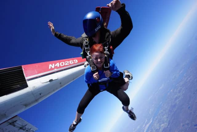 Marie Nester, division director at Greystone Programs, jumping out of a plane at last year's Leap For Autism.