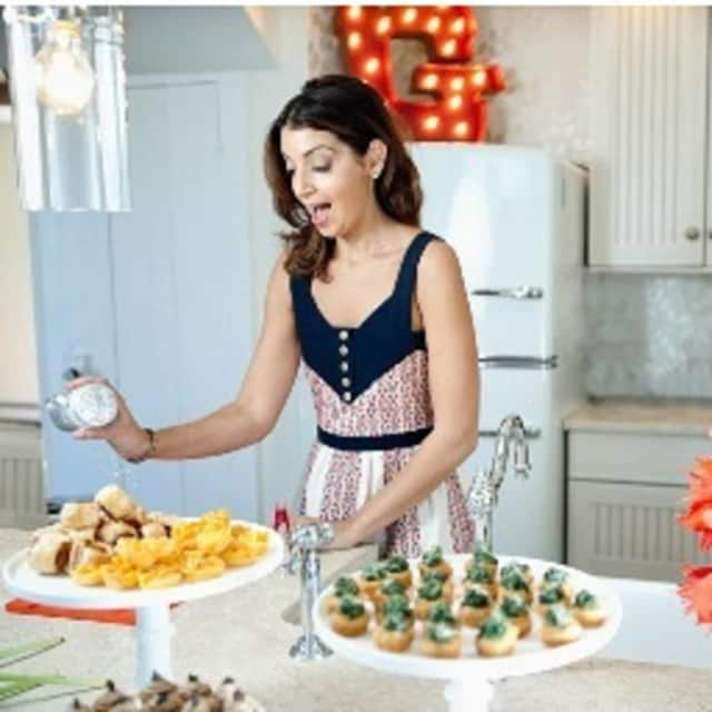 """Caterer to the stars Mary Giuliani will discuss her new book, """"The Cocktail Party: Eat Drink Play Recover"""" Nov. 18 at the New Canaan Library."""