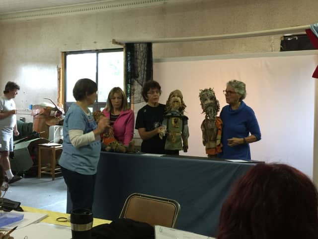 """Mary Schreiber prepares the puppets for an upcoming production of """"Beowulf"""" at Lake Carmel Arts Center."""
