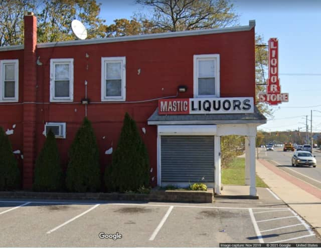 Police said one of the clerks who was charged was working at Mastic Liquors on Montauk Highway in Mastic.