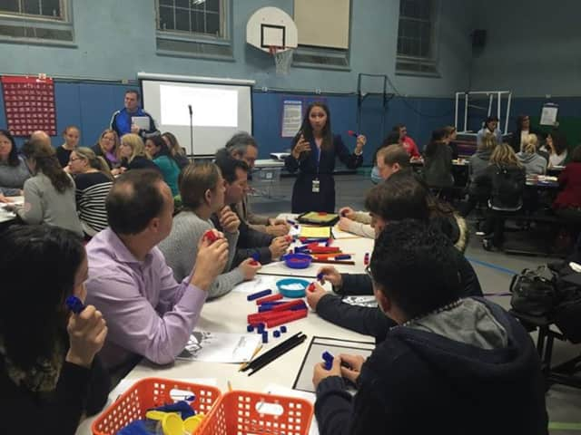 "Parents listen to ""math in focus"" discussion"