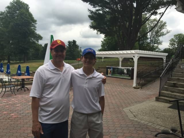 Matthew DeRosa and his dad at the Putnam County Golf Course after Matthew's hole-in-one.