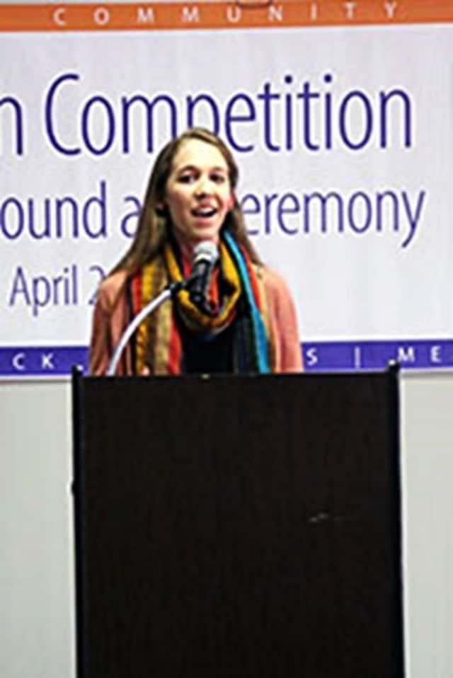 Maycie Schmidt won the College's speech competition.