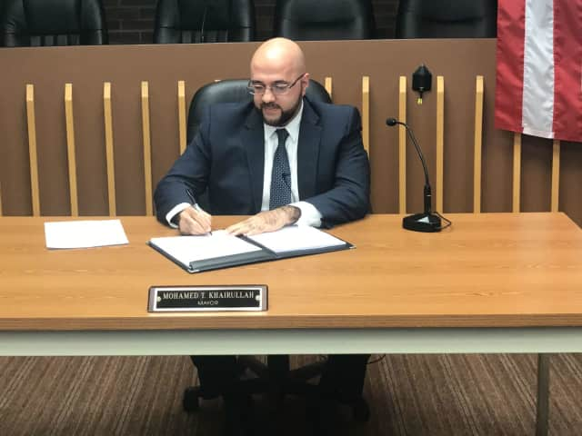 Prospect Park Mayor Mohamed T. Khairullah signs an executive order upholding the borough's anti-discrimination policies.