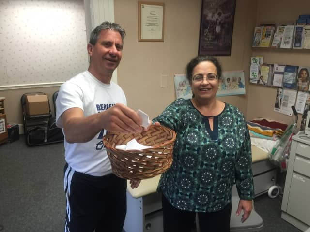 Bergenfield Mayor Norman Schmelz picks raffle winners at the conclusion of the Mayors Wellness Challenge.