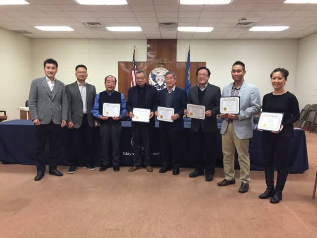 From left to right, Deputy Mayor Jongchul Lee, Council President Christopher Chung, Chun Sik Pak, Andy Nam, Young B. Cho, Jay W. Lee, Danny D. Kim, and Ruby Kim.