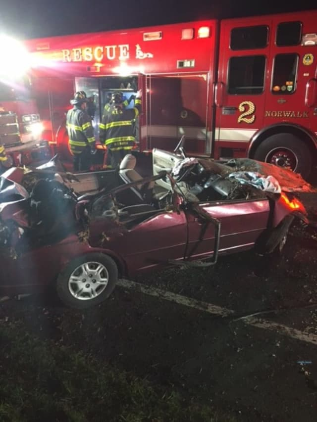 A woman received life-threatening injuries after being extricated from a vehicle following a crash.