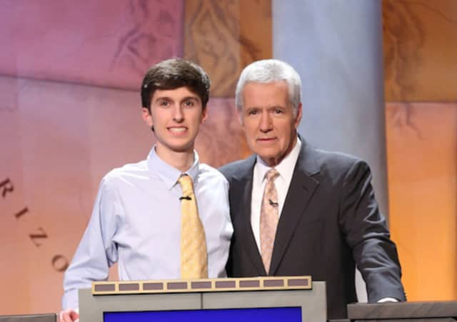 Michael Borecki of Darien, a competitor in the 2016 'Jeopardy Teen Tournament,' is with the show's host, Alex Trebek.
