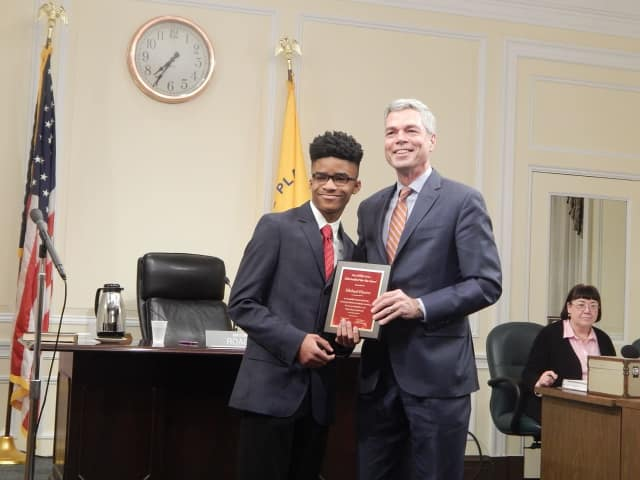 Michael Hunter receiving his Youth of the Year award from White Plains Mayor Thomas Roach.