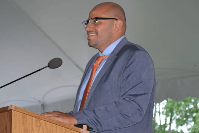 Horace Greeley High School Assistant Principal Michael Taylor, pictured speaking at the school's 2014 graduation.