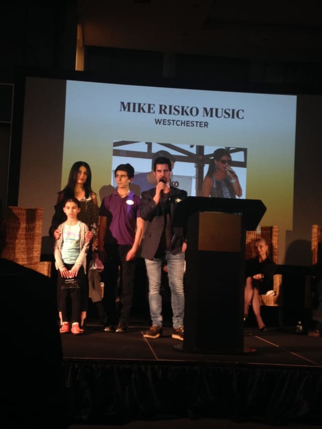 Mike Risko, owner of the Ossining  music store and school that bears his name, with his wife Miriam and their children. The Risko family received an award honoring the most outstanding family-owned businesses in Westchester.