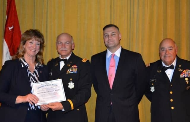 From left, state Rep. Laura Hoydick, Commandant of the First Co. Governor's Horse Guards Maj. Christopher Miller, President of the Friends of the First Co. Governor's Horse Guards Maj. Michael Downes and Lt. Colonel Andrew Arsenault.