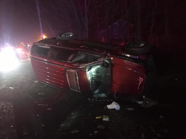 The occupants of this one-car roll-over crash on Elm Street in Monroe escaped without injury early Sunday, fire and police officials said.