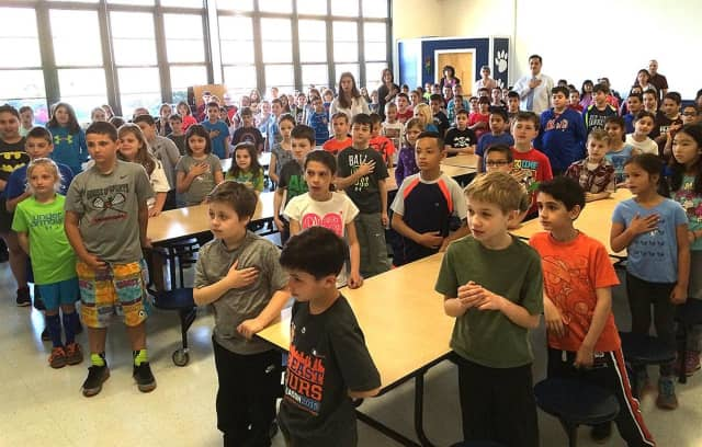Columbus Elementary School students record the Pledge of Allegiance in Mount Pleasant.