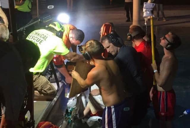 Valhalla firefighters and other rescue crews cut a section of the Mount Pleasant Town Pool wall Wednesday to free a boy whose finger had gotten stuck in a drain
