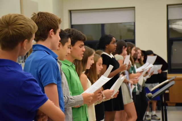 """The Irvington Middle School Music Honor Society induction ceremony Oct. 8 began with a student performance of """"America the Beautiful."""" Thirty-one seventh- and eighth-graders were inducted into the club, joining 18 other students previously inducted."""