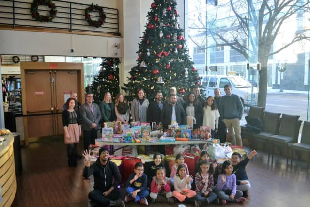 NBCUniversal employees welcomed the Boys & Girls Club of Stamford to the Stamford Media Center, where they received the annual holiday toy drive collection.