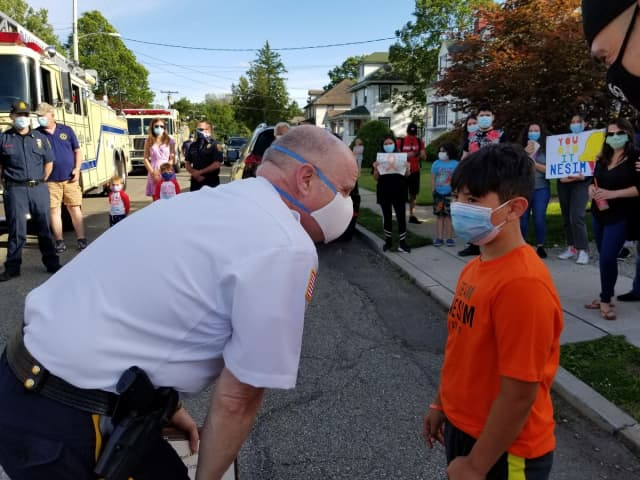 Sheriff Gannon with Nesim on Kanouse Street in Boonton, where the family lives.