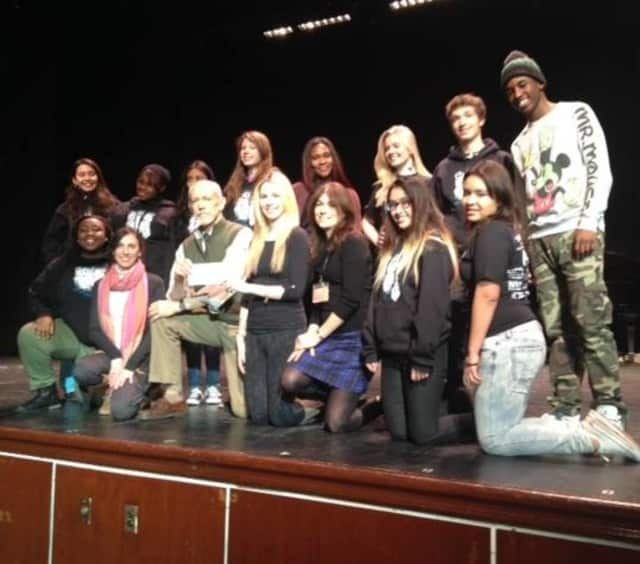 Michael Shannon (front row) presents a scholarship award to an Englewood Idol contestant.