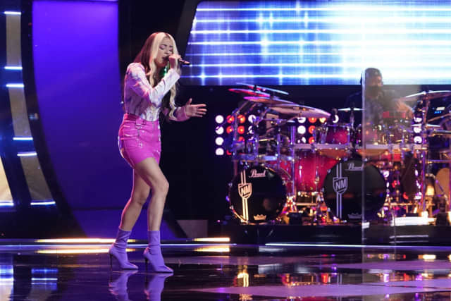 """Danielle Escobar, known musically as Yellsmiles, took to the stage during Tuesday night's episode of 'The Voice' and belted out a cover of Miley Cyrus' """"Midnight Sky."""""""