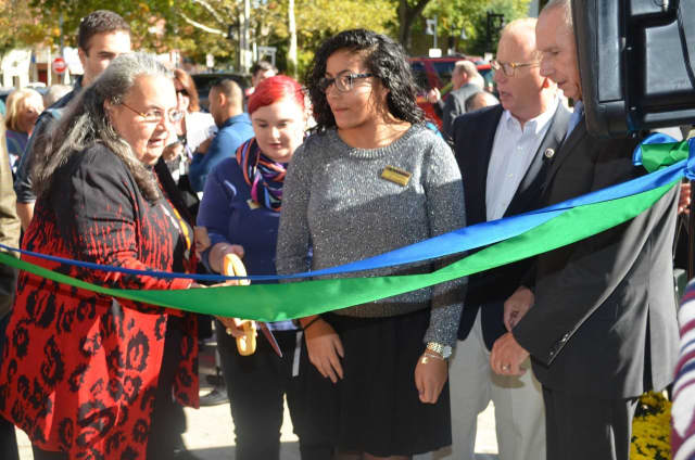 Naugatuck Valley Community College President Daisy Cocco De Filippis takes the lead in the ribbon-cutting ceremony for the new campus in Danbury.