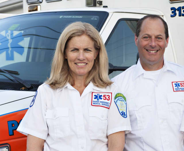Nancy Herling and outgoing Darien EMS-Post 53 Director Ron Hammer.