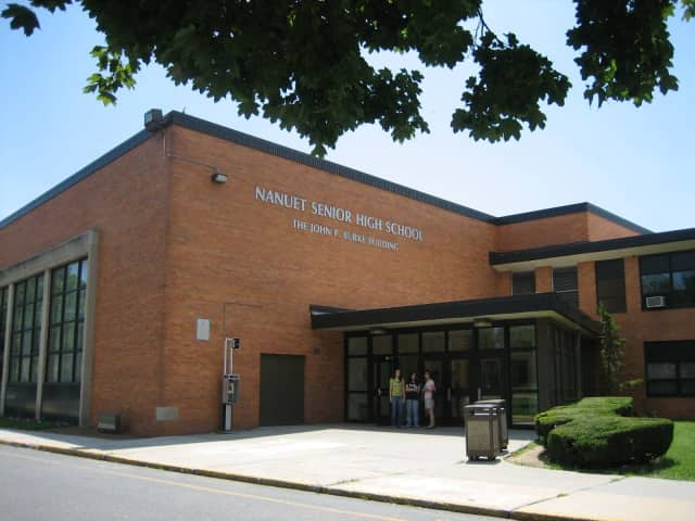 A Nanuet High School student was approached by a pair in a white school bus.