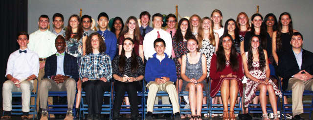 The 28 new members of the Pleasantville High School chapter of the National Honor Society at a recent induction ceremony.