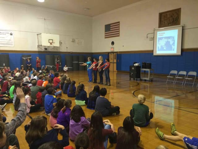 Parent Jen Argenta recently spoke with sixth- graders about the Neolithic area during an interactive presentation.
