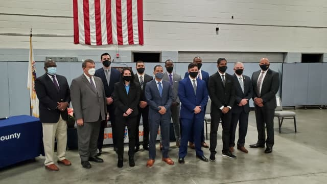 Deputy County Executive Jenkins and County Executive Latimer are to the far left; Deputy Police  Commissioner Terrance Raynor and Police Commissioner Thomas A. Gleason are to the far right; the new officers are in the center.