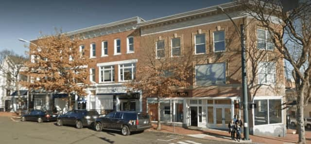 A sprinkler system kept a small fire from turning into a big one at this Main Street building in New Canaan on Monday night.