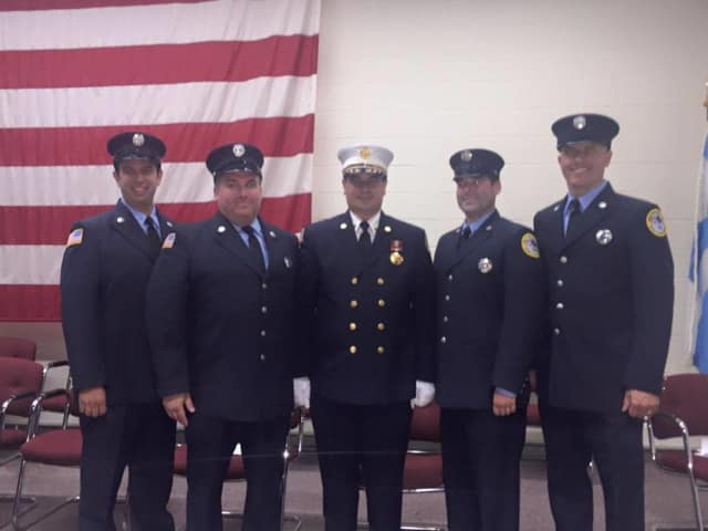 The four newest members of the New City Fire Department were honored by Fire Chief Dennis Rodriguez during a ceremony Thursday night. From left to right: Jack Holden, Marc Ackerman, Rodriguez, Mike Krychear and Jim Morris.