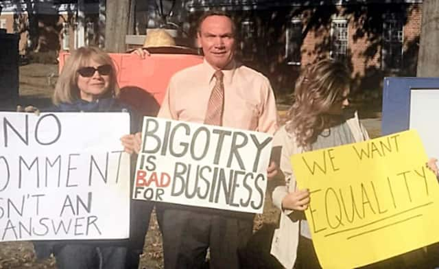 New Milford Councilwoman Hedy Grant, left, and Assemblyman Tim Eustace were joined by others in Oradell on Friday in protesting Affinity Credit Union's support of U.S. Rep. Scott Garrett.