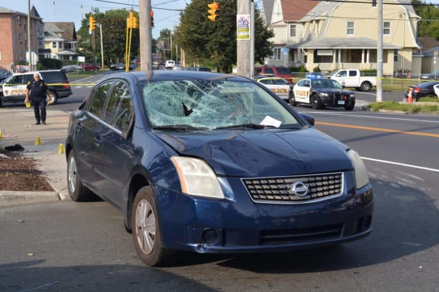 Two crossing guards were hit by a car Tuesday morning in Bridgeport. One remains in critical condition.