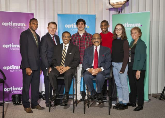(left to right, standing) Principal Roberts, Kerry Donovan, Max Berman, Saadiq Sterling, Hailey Agostino and Dr. Carol Marinaccio; (left to right, seated) Bruce V. Morris and Bruce L. Morris