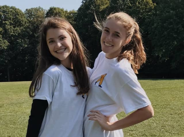 Academy of the Holy Angels students Olivia Mandella and Abigail Sheehan spearheaded a 5K to raise funds for pediatric cancer research.