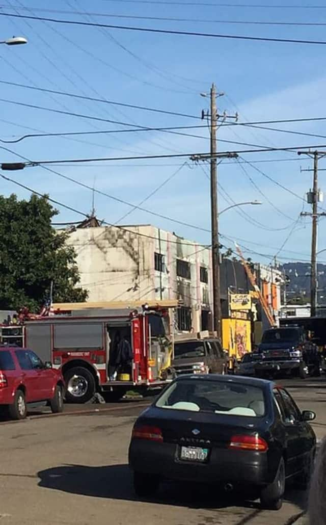 A Staples High graduate died in a massive fire over the weekend in Oakland, Calif.