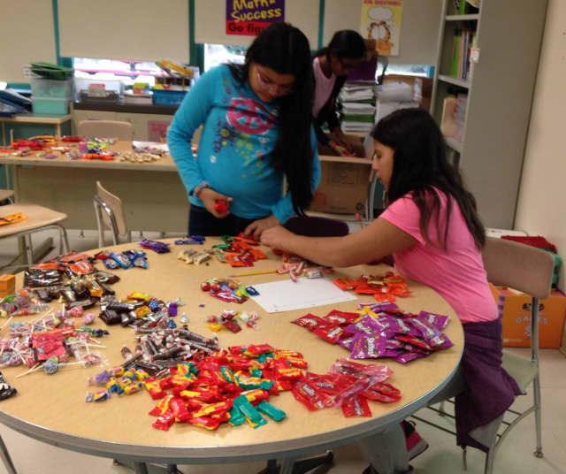 Elmsford students collected candy for veterans after Halloween -- and put their math skills to work.