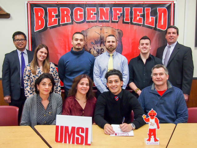 Bergenfield High School senior Kevin Ordonez signs his commitment to the University of Missouri at St. Louis.