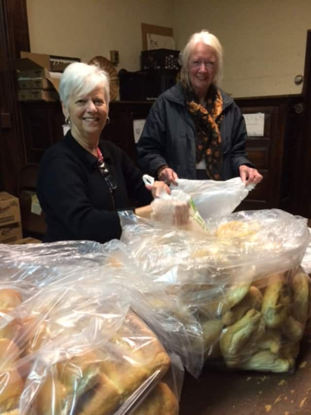 Christina Cafarelli and Karin Chaudhari from Ossining Food Pantry with bags of bread donated by the Ossining Bakery