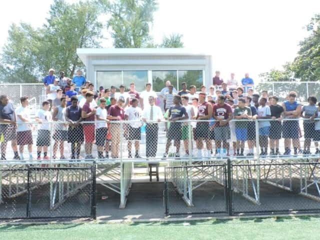 The Ossining football team joined school officials in thanking State Sen. David Carlucci and took part in the ribbon-cutting ceremony.