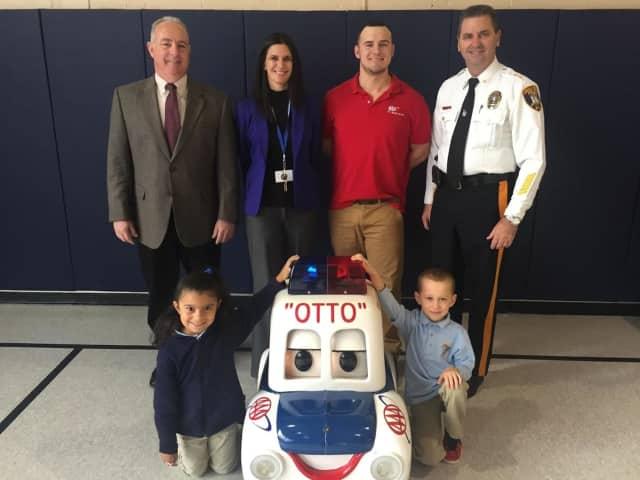 Saddle Brook Mayor Robert White, Principal Toni Violetti, a AAA representative, and Police Chief Robert Kugler attend the Otto the Auto program.