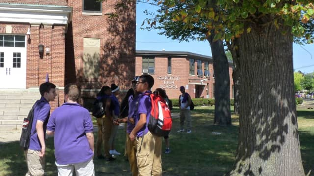 Students gather outside Garfield High School.